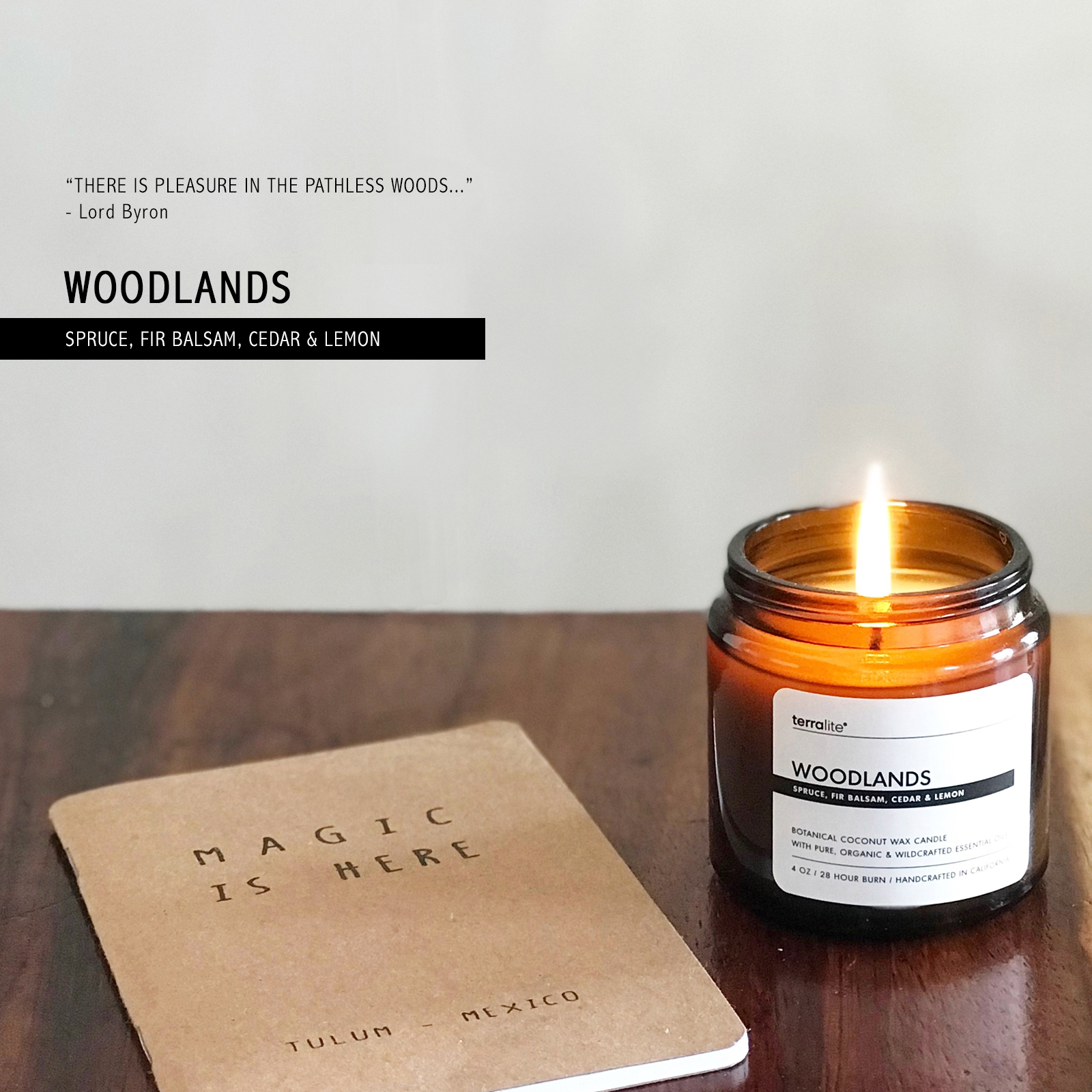 Woodlands Coconut Wax Candle made with essential oils of spruce, fir balsam, cedarwood, and lemon in an amber glass jar.